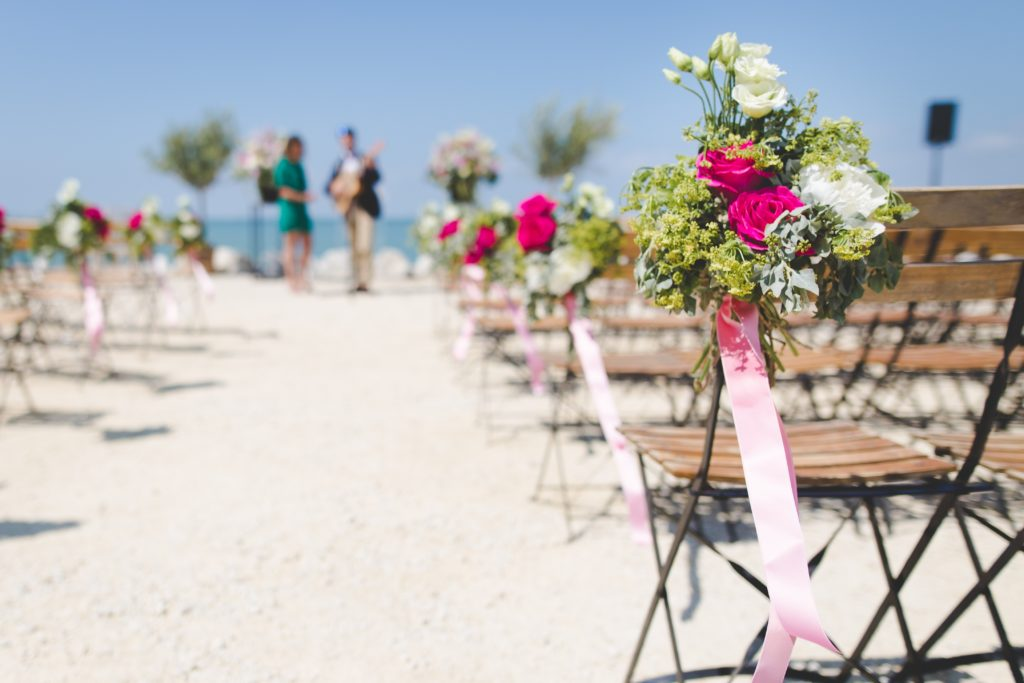 Where to get married? A wedding on a beach with folding chairs