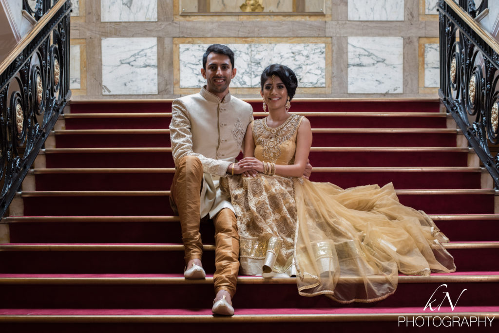 A couple sitting on the steps of a London wedding venue