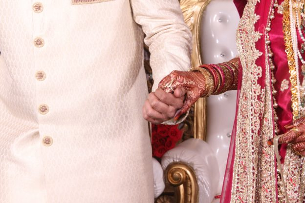 Asian wedding couple holding hands