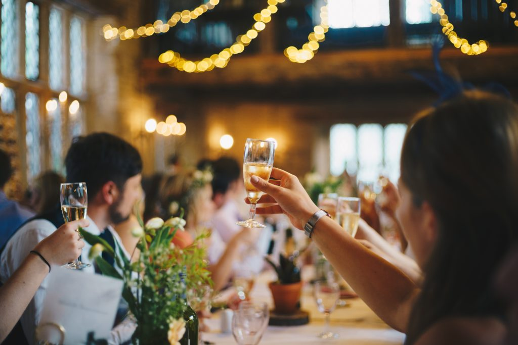 wedding guests raising a toast